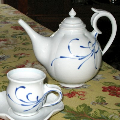 By Andrew Boswell. Wheel thrown, hand painted, grolleg porcelain teapot and cup and saucer.